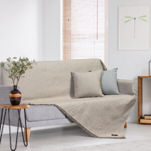 Plant on wooden table next to grey sofa in natural living room i